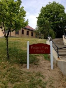 Sign at PFL's back entrance (corner of Front & Summer Streets) generously donated by the Friends of Patten Free Library.