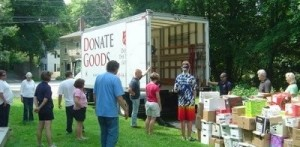 Volunteers donating books to Salvation Army